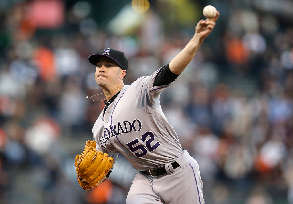 . Colorado Rockies starter Chris Rusin throws to the San Francisco Giants during the first inning of a baseball game Thursday, May 5, 2016, in San Francisco. (AP Photo/Marcio Jose Sanchez)