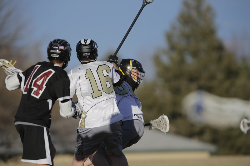 JPM0474-JPM0474-Jonathan first HS lacrosse game March 9th.jpg