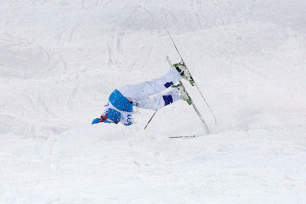 . Ville Miettunen of Finland crashes out in the Men\'s Moguls Qualification on day three of the Sochi 2014 Winter Olympics at Rosa Khutor Extreme Park on February 10, 2014 in Sochi, Russia.  (Photo by Cameron Spencer/Getty Images)