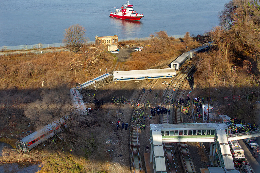 ". A New York Fire Department boat approaches the scene of a Metro-North passenger train in the Bronx borough of New York Sunday, Dec. 1, 2013. The train derailed on a curved section of track early Sunday morning, causing ""multiple injuries,\"" authorities said.  (AP Photo/Craig Ruttle)"