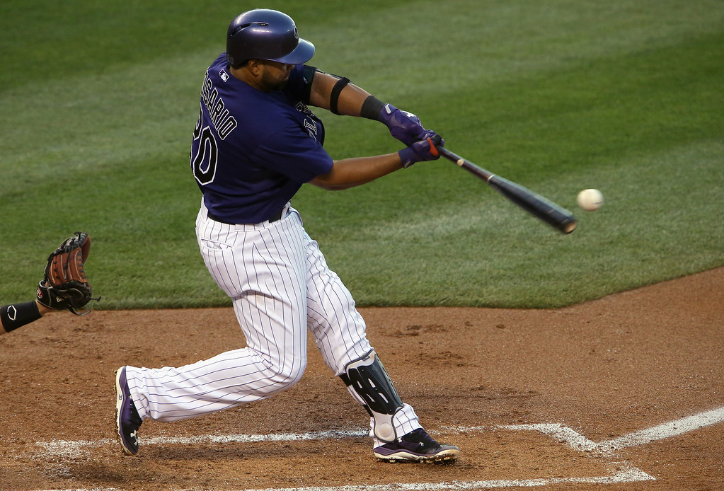 . Wilin Rosario #20 of the Colorado Rockies hits a three run home run off of starting pitcher Ryan Vogelsong #32 of the San Francisco Giants at Coors Field on April 21, 2014 in Denver, Colorado.  (Photo by Doug Pensinger/Getty Images)