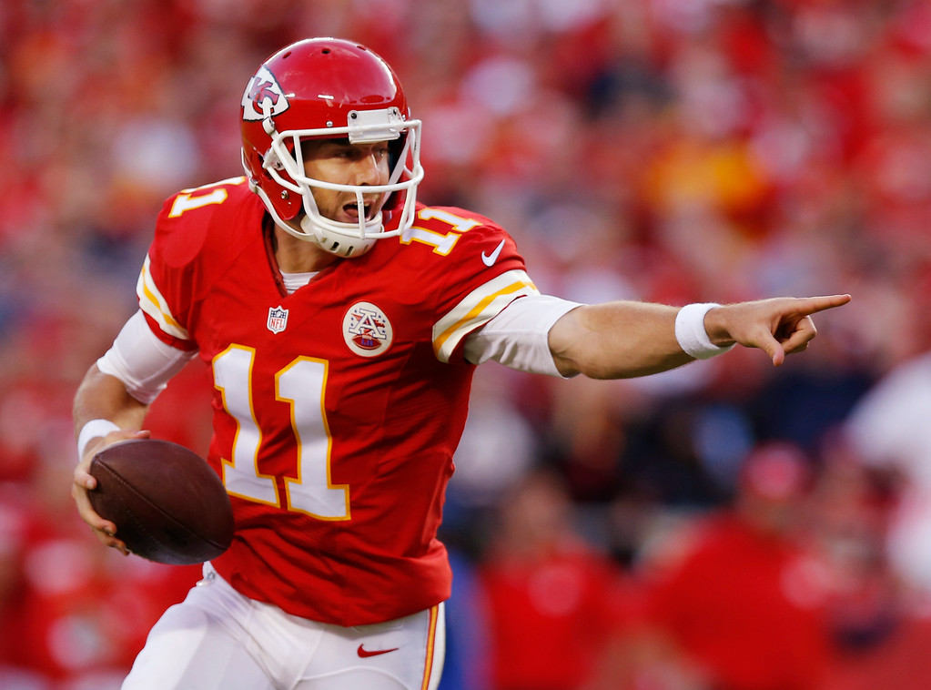 . Kansas City Chiefs quarterback Alex Smith (11) directs his receivers during the second half of an NFL football game against the Houston Texans at Arrowhead Stadium in Kansas City, Mo., Sunday, Oct. 20, 2013. (AP Photo/Ed Zurga)
