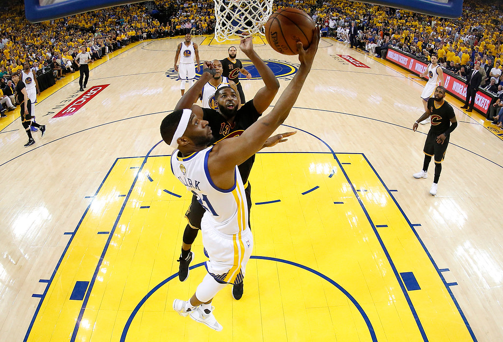 . Golden State Warriors guard Ian Clark (21) shoots against Cleveland Cavaliers center Tristan Thompson during the second half of Game 2 of basketball\'s NBA Finals in Oakland, Calif., Sunday, June 4, 2017. (John G. Mabanglo/Pool Photo via AP)