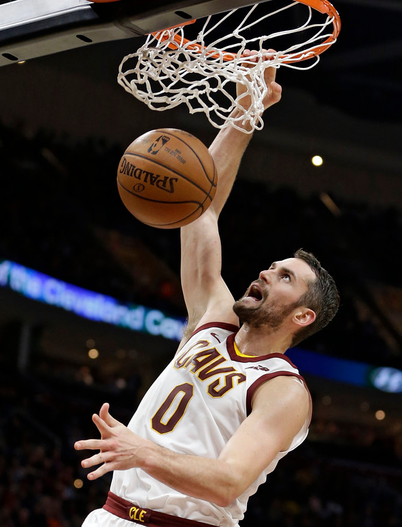 . Cleveland Cavaliers\' Kevin Love dunks the ball against the Miami Heat in the first half of an NBA basketball game, Tuesday, Nov. 28, 2017, in Cleveland. (AP Photo/Tony Dejak)
