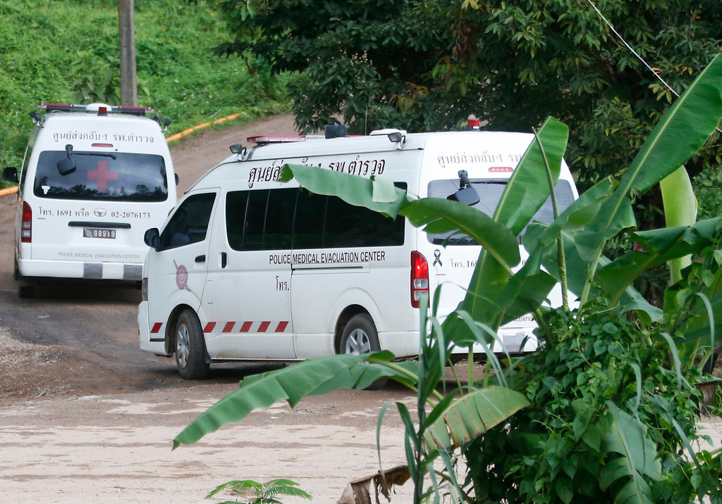 . Two ambulances arrive near the cave to wait for more evacuations of the boys and their soccer coach who have been trapped since June 23, in Mae Sai, Chiang Rai province, northern Thailand Monday, July 9, 2018. Thailand\'s interior minister says the same divers who took part in Sunday\'s rescue of four boys trapped in a flooded cave will also conduct the next operation as they know the cave conditions and what to do. (AP Photo/Sakchai Lalit)