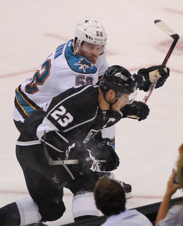. The San Jose Sharks Matt Irwin checks the Kings Dustin Brown in the second period, Thursday, May 16, 2013, at Staples Center. (Michael Owen Baker/Staff Photographer)