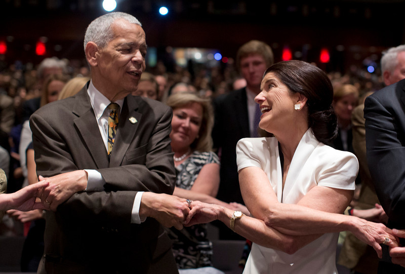 ". Social activist Julian Bond, and leader in the American civil rights movement, and Luci Baines Johnson, the younger daughter of President Lyndon Baines Johnson, join hands as they sing ""We Shall Overcome\"" before President Barack Obama spoke at the LBJ Presidential Library, Thursday, April 10, 2014, in Austin, Texas, during the Civil Rights Summit to commemorate the 50th anniversary of the signing of the Civil Rights Act. (AP Photo/Carolyn Kaster)"