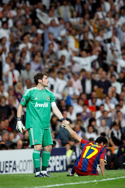 Casillas helping Pedro to get up, UEFA Champions League Semifinals game between Real Madrid and FC Barcelona, Bernabeu Stadiumn, Madrid, Spain
