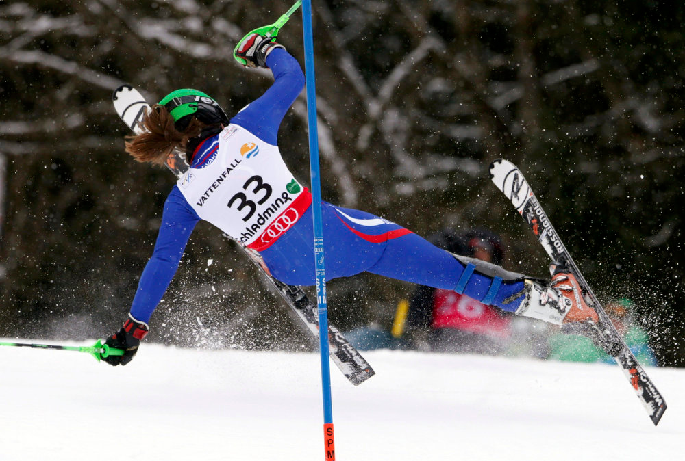 Description of . Petra Vlhova of Slovakia falls during the first run of the women's Slalom race at the World Alpine Skiing Championships in Schladming February 16, 2013. REUTERS/Ruben Sprich