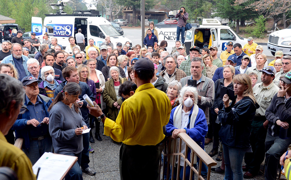 . Big Sur residents, buisness owners, media and others gathered as U.S. Forest Service Incident Commander Mark Nunez gave a briefing on the fire at the Big Sur Staion in Big Sur, Calif. on Tuesday December 17, 2013. (Photo David Royal/ Monterey County Herald)