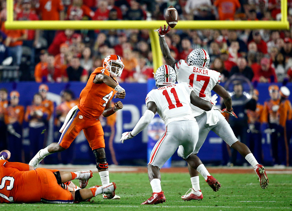 . Clemson quarterback Deshaun Watson (4) has his pass deflected by Ohio State linebacker Jerome Baker (17) during the first half of the Fiesta Bowl NCAA college football playoff semifinal, Saturday, Dec. 31, 2016, in Glendale, Ariz. (AP Photo/Ross D. Franklin)