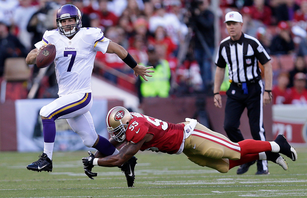 . Vikings quarterback Christian Ponder scrambles away from 49ers linebacker Ahmad Brooks during the second quarter. (AP Photo/Marcio Jose Sanchez)