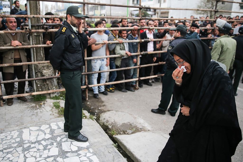. Samereh Alinejad (R), the mother of Abdolah Hosseinzadeh who was killed by a fellow Iranian, Balal, in a street fight with a knife in 2007, cries after she spared the life of her son\'s convicted murderer with an emotional slap in the face as he awaited execution with the noose around his neck in the northern city of Nowshahr on April 15, 2014. AFP PHOTO/ARASH KHAMOOSHI/AFP/Getty Images