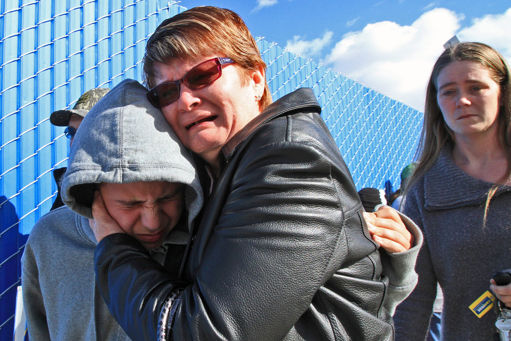 . A family member weeps and hugs a student who emerged from Taft Union High School in Kern County, California, on Thursday, January 10, 2013, after a student opened fire in a classroom. (Irfan Khan/Los Angeles Times/MCT)