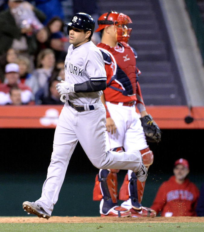 . New York Yankees\' Brian Roberts crosses home plate past Los Angeles Angels catcher Hank Conger after hitting a solo home run in the ninth inning of a baseball game Los Angeles Angels gainst the \\at Anaheim Stadium in Anaheim, Calif., on Tuesday, May 6, 2014.  (Keith Birmingham Pasadena Star-News)