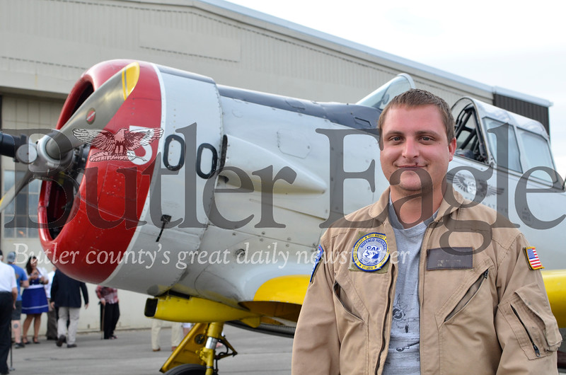 Greg Barnhard stands with the Buffalo Heritage Squadron's 1943 SNJ-4. Barnhard is a volunteer pilot and operations manager with the Akron, New York, organization. They gave people flights in the plane during Saturday's mock USO event. Tanner Cole/Butler Eagle