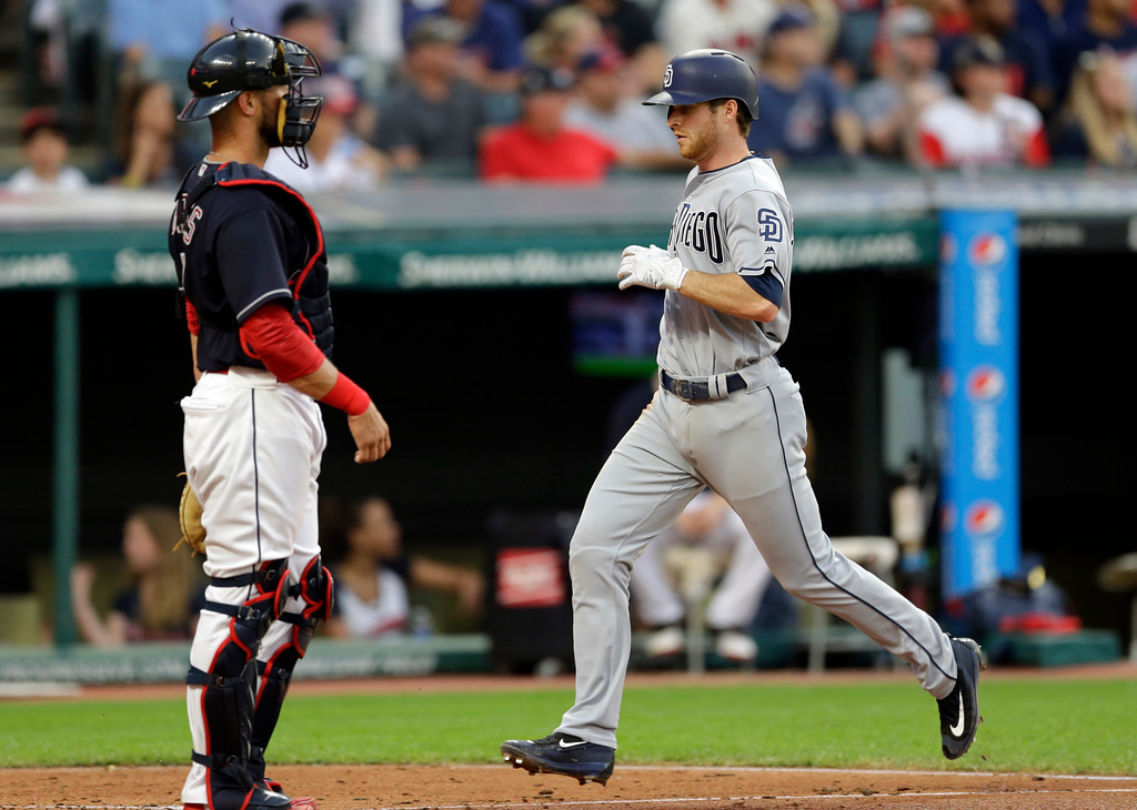 . San Diego Padres\' Cory Spangenberg, right, scored as Cleveland Indians catcher Cleveland Indians\' Yan Gomes waits in the fifth inning of a baseball game, Thursday, July 6, 2017, in Cleveland. Spangenberg scored on a sacrifice fly by Allen Cordoba. (AP Photo/Tony Dejak)