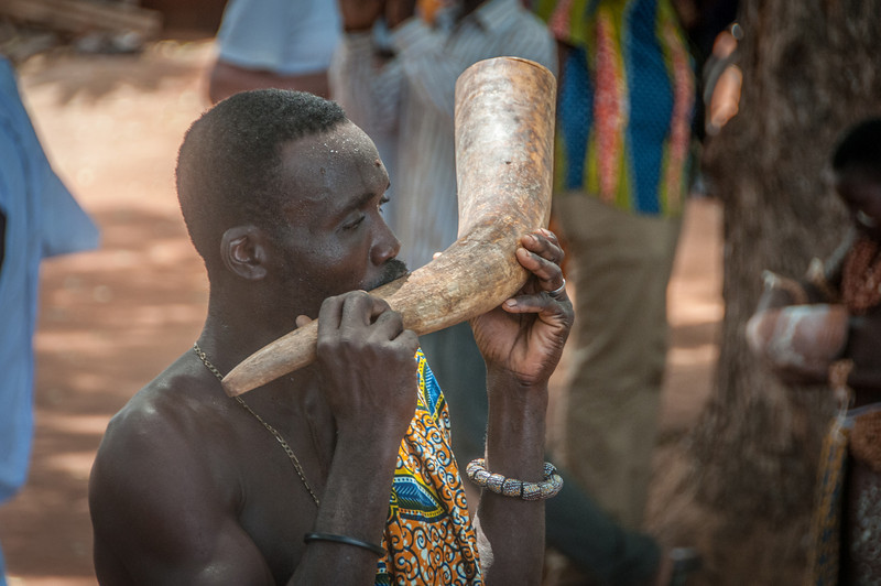 Blowing of horns during traditional performance in Lome, Togo