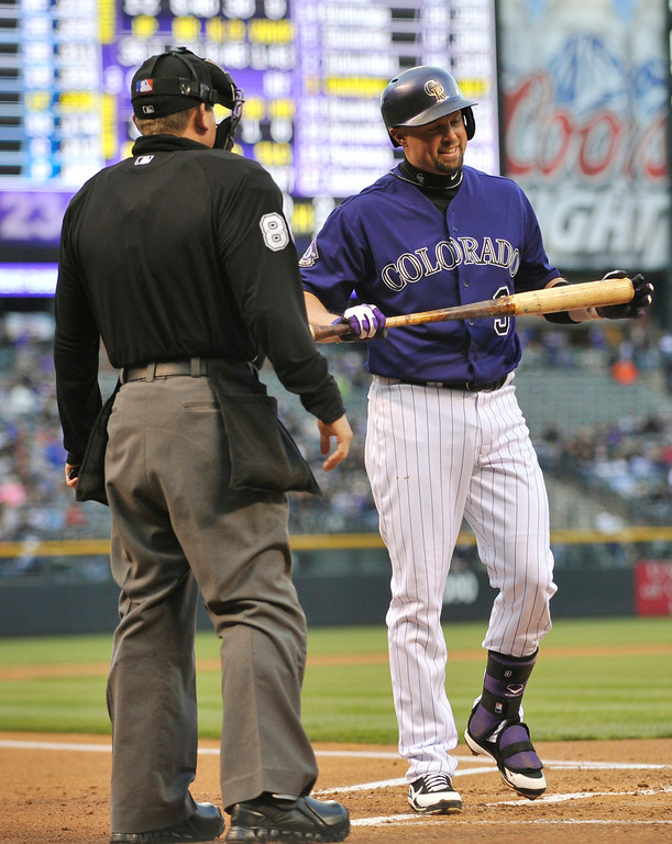 . Colorado Rockies\' Michael Cuddyer (3) discusses a strike call by home plate umpire Clint Fagan during the first inning of a baseball game against the Tampa Bay Rays on Saturday, May 4, 2013, in Denver. (AP Photo/Jack Dempsey)