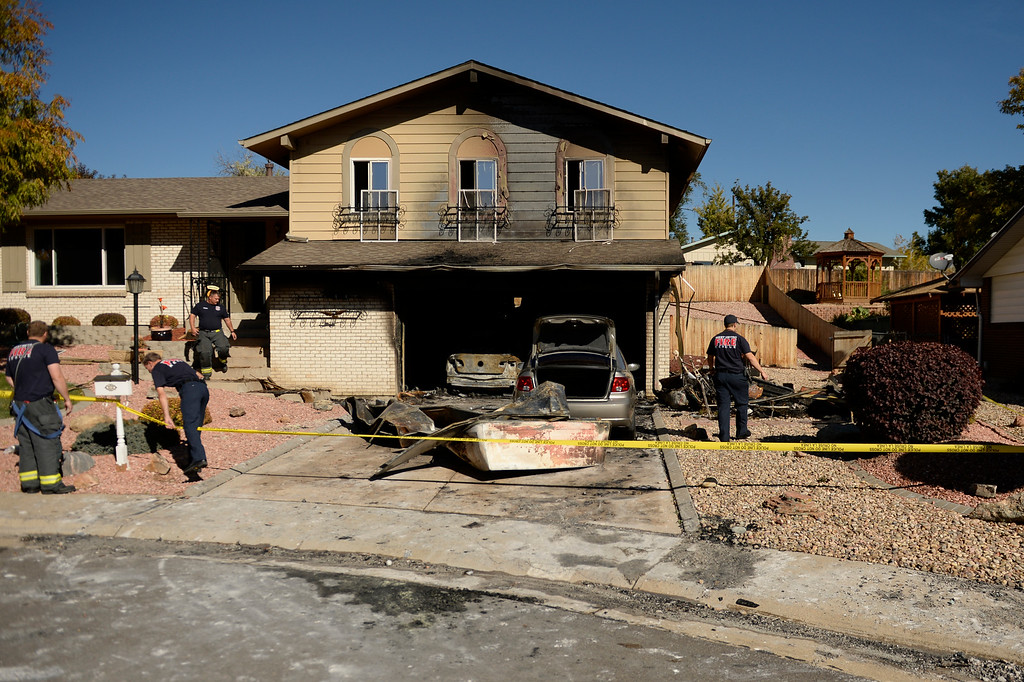 . Fire crews from West Metro Fire investigate a fire near West Alaska Place and Carr Street in Lakewood, October 22, 2013. (Photo By RJ Sangosti/The Denver Post)