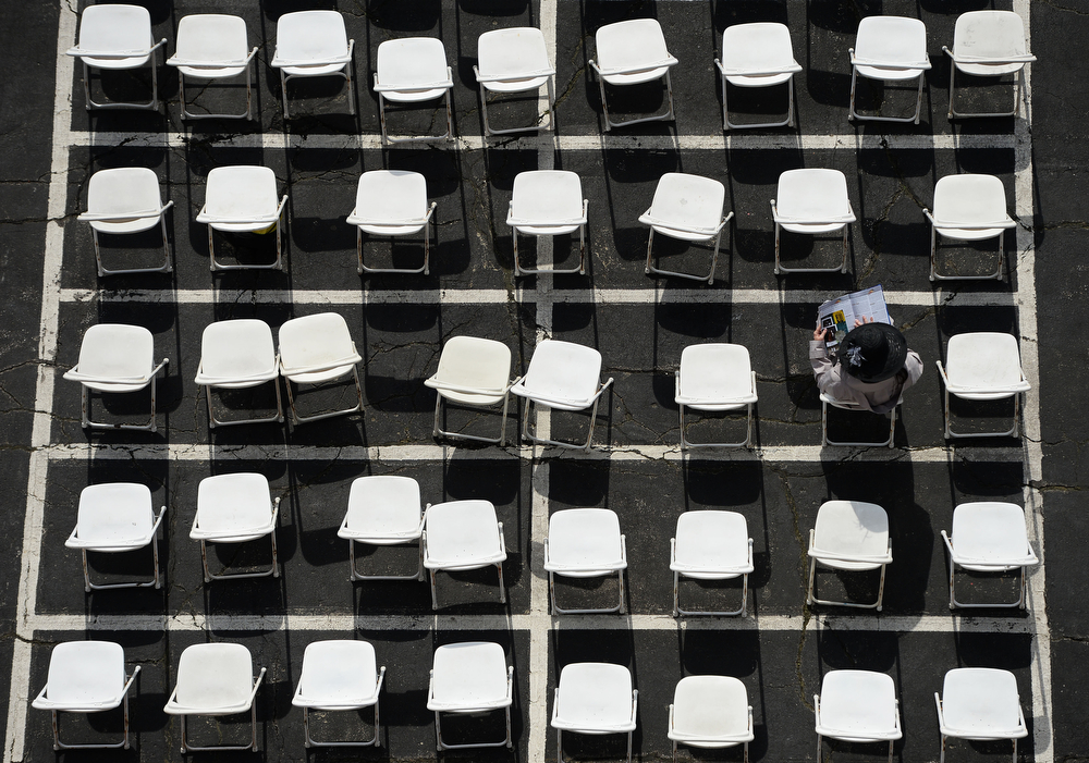 . A fan looks on from seating prior to the 139th running of the Preakness Stakes at Pimlico Race Course on May 17, 2014 in Baltimore, Maryland.  (Photo by Patrick Smith/Getty Images)