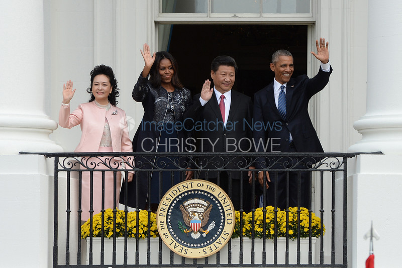 President Barack Obama  and First Lady Michelle welcomes President Xi and Madame Peng Liyuan  of China to the White House  during an official State Visit on the South Lawn.