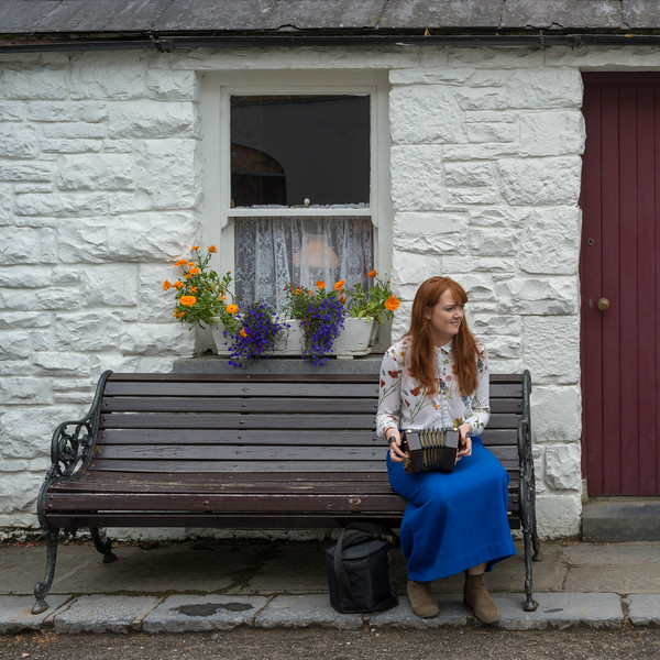 Woman playing Squeezebox outside store, Bunratty, County Clare, Republic of Ireland