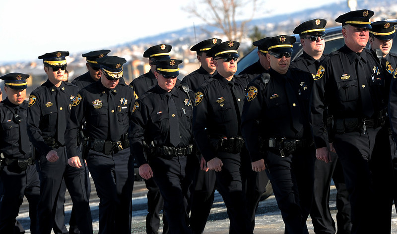 . Members of Douglas County Sheriff\'s department fall in formation as they head towards New Life Church for the public memorial service for Tom Clements on March 25, 2013.  Family, friends and corrections and police officers from all over the nation came to the public memorial service for Tom Clements  at New Life Church in Colorado Springs on March 25, 2013.  Hundreds turned out to pay their respects to Clements who was the executive director of the Colorado Department of Corrections, Tom Clements, was shot and killed as he opened the door to his Monument home on March 19, 2013.  (Photo By Helen H. Richardson/ The Denver Post)