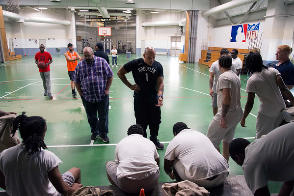 08/14/19 Wesley Bunnell | StaffrrThe Manson Youth Institution is implementing a basketball league, based off the New Britain Legacies Youth Development & Basketball Program, for inmates aged 14 to 21 to have a chance to play organized basketball with the qualification that inmates abide by the strict rules of the facility. Correctional Officer and program coach Derek Grasper, middle, speaks with the inmates prior to the start of the first tryout. r