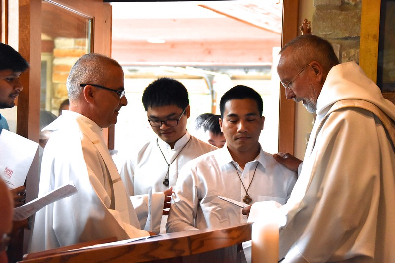 Fr. Byron welcomes the postulants to the novitiate