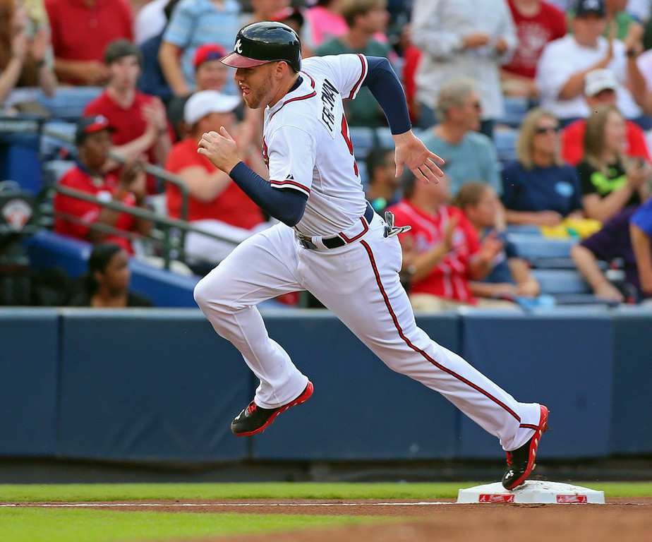 . Atlanta\'s Freddie Freeman rounds third to score on an RBI single by Brian McCann during the first inning. (Curtis Compton/Atlanta Journal-Constitution/MCT)
