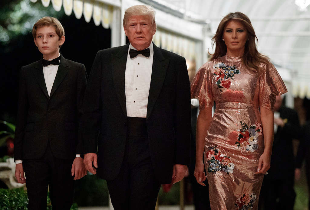 . President Donald Trump arrives for a New Year\'s Eve gala at his Mar-a-Lago resort with first lady Melania Trump and their son Barron, Sunday, Dec. 31, 2017, in Palm Beach, Fla. (AP Photo/Evan Vucci)
