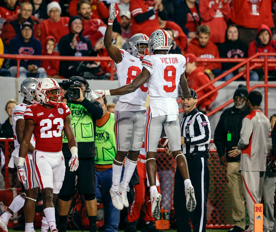 . Ohio State wide receiver Terry McLaurin (83) celebrates his touchdown with wide receiver Binjimen Victor (9) as Nebraska defensive back Dicaprio Bootle (23) watches, during the first half of an NCAA college football game in Lincoln, Neb., Saturday, Oct. 14, 2017. (AP Photo/Nati Harnik)