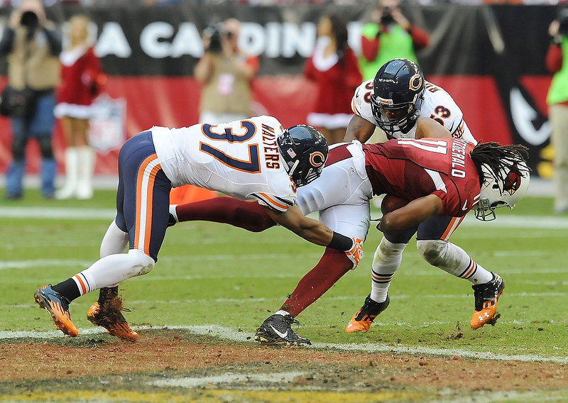 . Anthony Walters #37 and Nick Roach #53 of the Chicago Bears tackle Larry Fitzgerald #11 of the Arizona Cardinals at University of Phoenix Stadium on December 23, 2012 in Glendale, Arizona. Bears won 28-13. (Photo by Norm Hall/Getty Images)