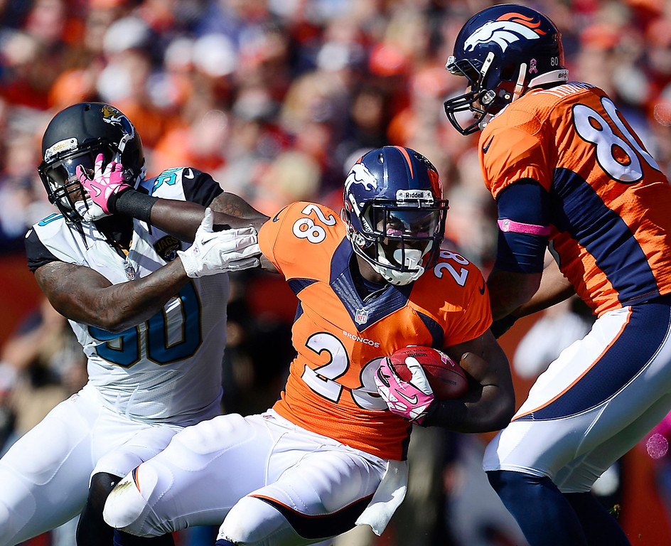 . Denver Broncos running back Montee Ball (28) fights off defender Jacksonville Jaguars defensive end Andre Branch (90) in the first quarter of their game at Sports Authority Field at Mile High in Denver on October 13, 2013. (Photo by AAron Ontiveroz/The Denver Post)