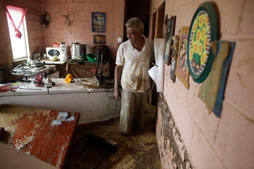 . Enrique Cota Cece�a shows to reporters what remains of his belongings after his house was severely damaged by flood waters from Hurricane Odile in Los Cabos, Mexico, Monday, Sept. 15, 2014. (AP Photo/Victor R. Caivano)