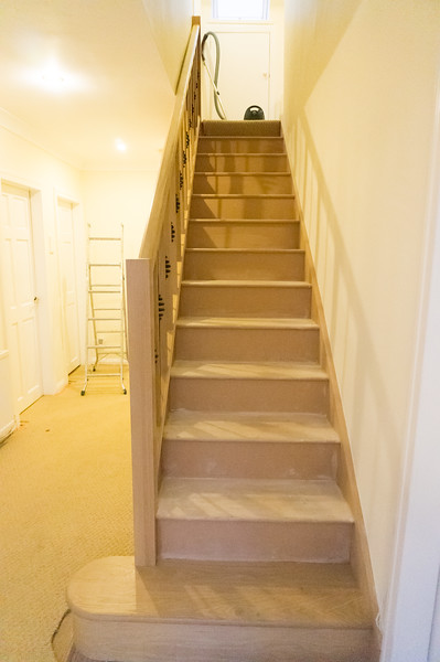New stair inplace with Solid Oak stringers, spindles and newel posts, inc. curved bottom step detail.