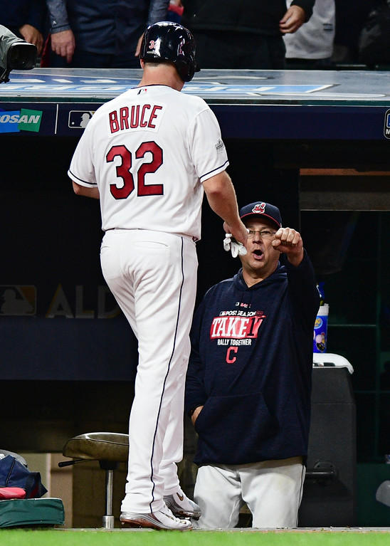 . Cleveland Indians manager Terry Francona, right, congratulates Jay Bruce after Bruce scored in the second inning of Game 1 of baseball\'s American League Division Series against the New York Yankees, Thursday, Oct. 5, 2017, in Cleveland. (AP Photo/David Dermer)