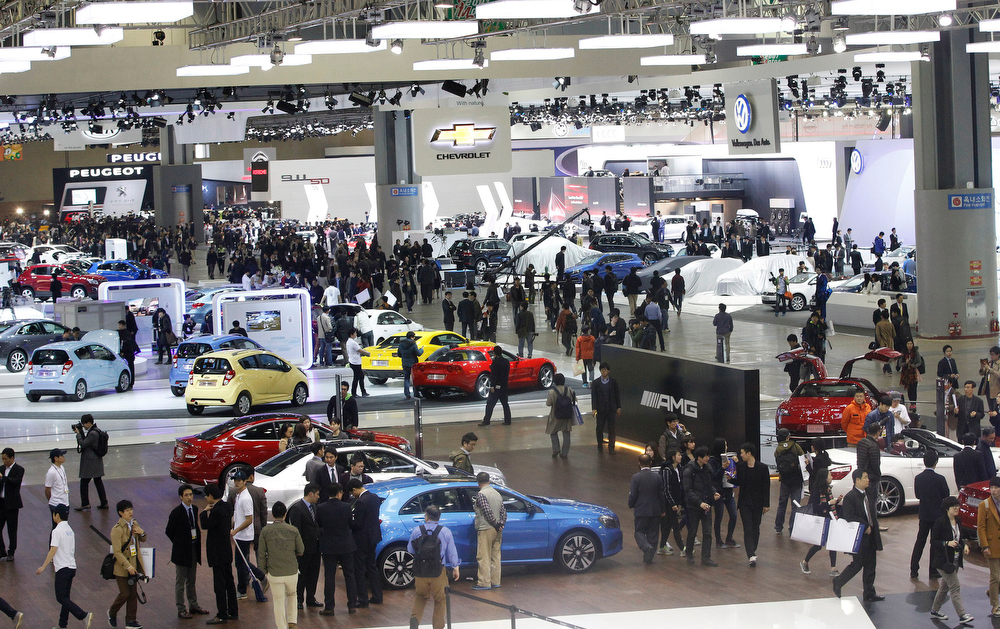 . Members of media participate in a press day of the Seoul Motor Show in Goyang, South Korea, Thursday, March 28, 2013. The exhibition, with 384 companies from 14 countries to participate in, will be held from March 29 through April 7. (AP Photo/Ahn Young-joon)