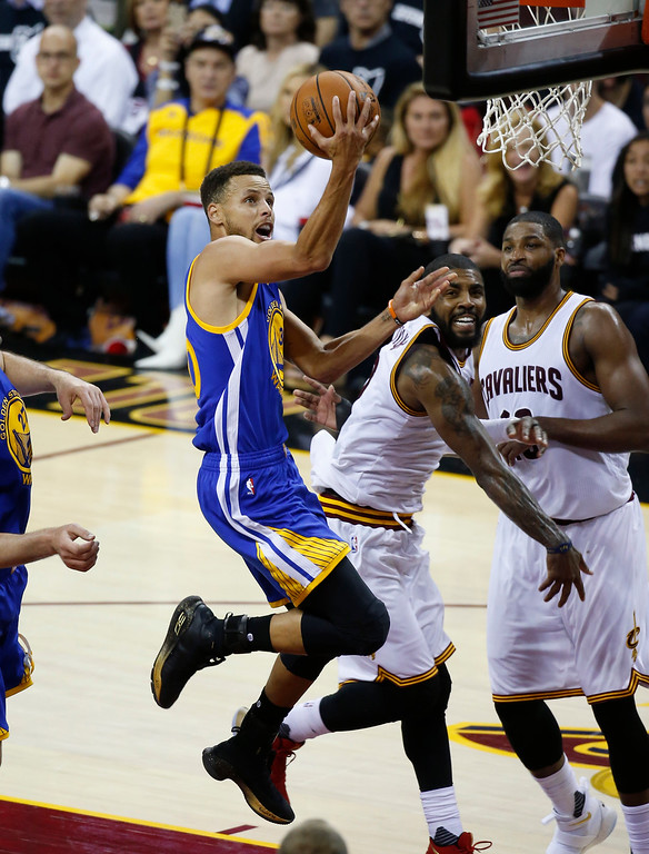 . Golden State Warriors guard Stephen Curry (30) drives on Cleveland Cavaliers guard Kyrie Irving (2) in the second half of Game 4 of basketball\'s NBA Finals in Cleveland, Friday, June 9, 2017. (AP Photo/Ron Schwane)