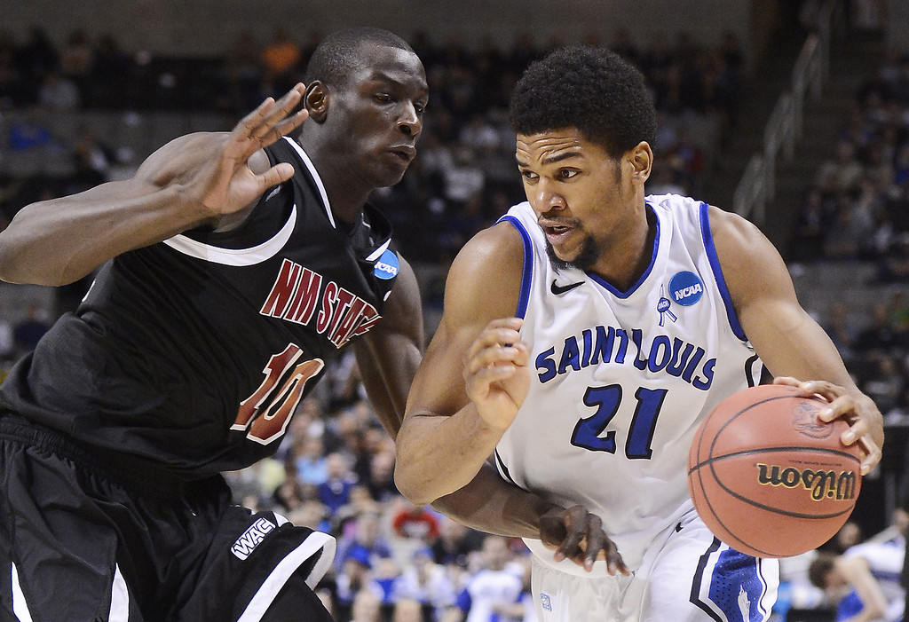 . Dwayne Evans #21 of the Saint Louis Billikens drives against Bandja Sy #10 of the New Mexico State Aggies in the first half during the second round of the 2013 NCAA Men\'s Basketball Tournament at HP Pavilion on March 21, 2013 in San Jose, California.  (Photo by Thearon W. Henderson/Getty Images)
