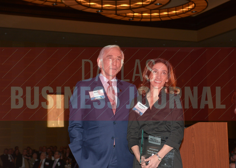 Michelle Caplan, right, stands with her father, Herb Weitzman as he recieves his Best Real Estate Deals Lifetime Acheivement Award.