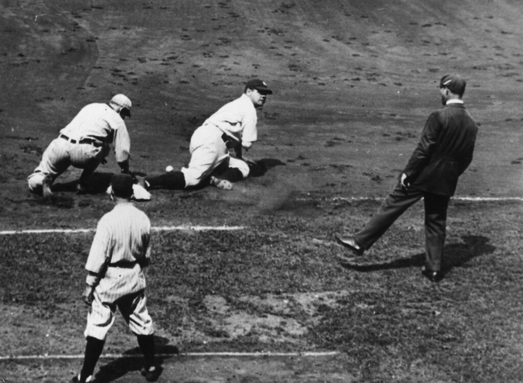 . circa 1925:  Babe Ruth (George Herman Ruth, 1895 - 1948) of the New York Yankees slides into first base after Bud Clancy of the Chicago White Sox dropped a throw.  (Photo by General Photographic Agency/Getty Images)