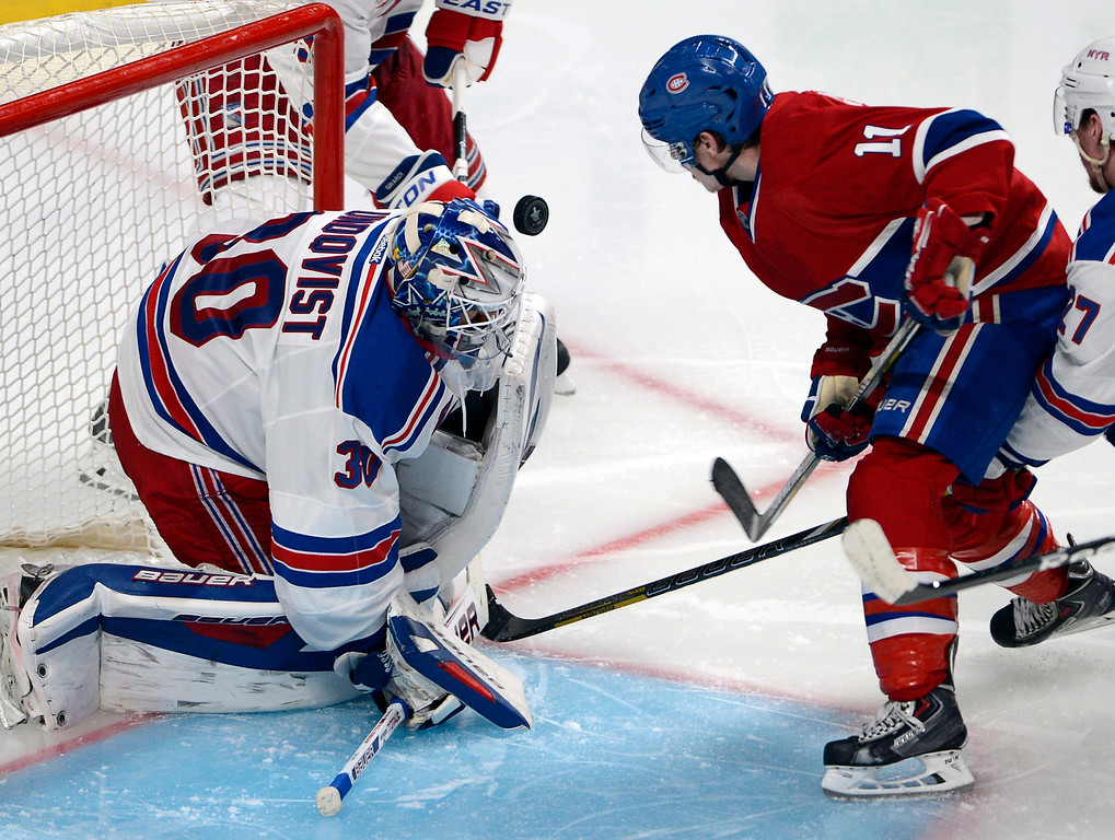 . New York Rangers goalie Henrik Lundqvist (30) stops Montreal Canadiens right wing Brendan Gallagher (11) during the third period in Game 2 of the NHL hockey Eastern Conference final Stanley Cup playoff series Monday, May 19, 2014, in Montreal. (AP Photo/The Canadian Press, Ryan Remiorz)
