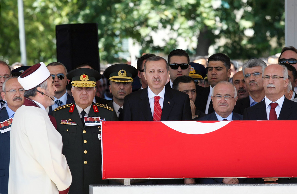 . Turkey\'s Prime Minister Recep Tayyip Erdogan, center left, Parliament Speaker Cemil Cicek, center right, Chief of Staff Gen. Necdet Ozel, third left, and other officials attend a religious funeral for Captain Gokhan Ertan, at a mosque in the eastern Turkish city of Malatya, Turkey, Friday, July 6, 2012. Turkey\'s Prime Minister Recep Tayyip Erdogan and top military commanders have joined hundreds of mourners at the funeral of two pilots whose jet was shot down by Syria two weeks ago. The somber ceremony took place at an air base in Malatya, from where the pilots\' plane had originally taken off. (AP Photo)