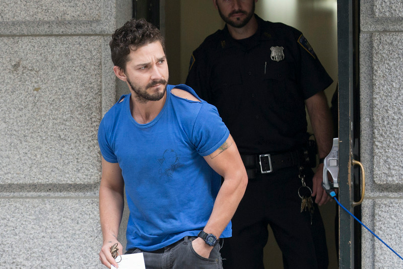 ". Actor Shia LaBeouf leaves Midtown Community Court after being arrested the previous day for yelling obscenities at the Broadway show ""Cabaret,\"" Friday, June 27, 2014, in New York. The 28-year-old star of the \""Transformers\"" franchise faces charges that include disorderly conduct and criminal trespass.  (AP Photo/John Minchillo)"