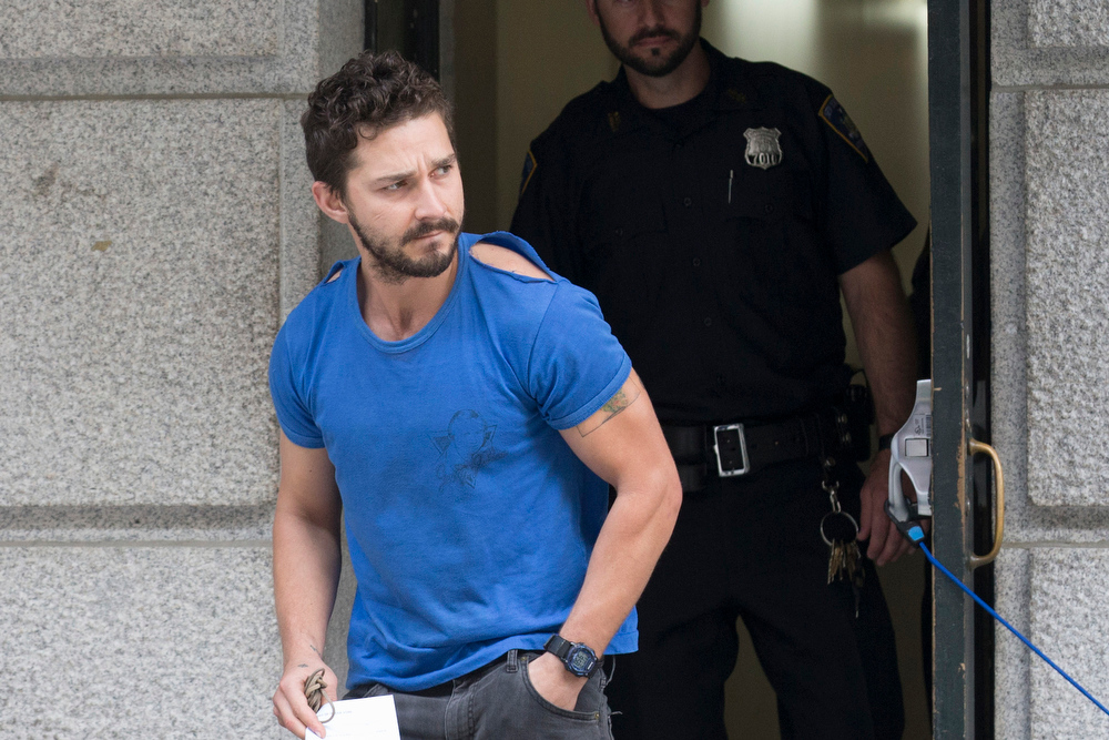 """. Actor Shia LaBeouf leaves Midtown Community Court after being arrested the previous day for yelling obscenities at the Broadway show \""""Cabaret,\"""" Friday, June 27, 2014, in New York. The 28-year-old star of the \""""Transformers\"""" franchise faces charges that include disorderly conduct and criminal trespass.  (AP Photo/John Minchillo)"""
