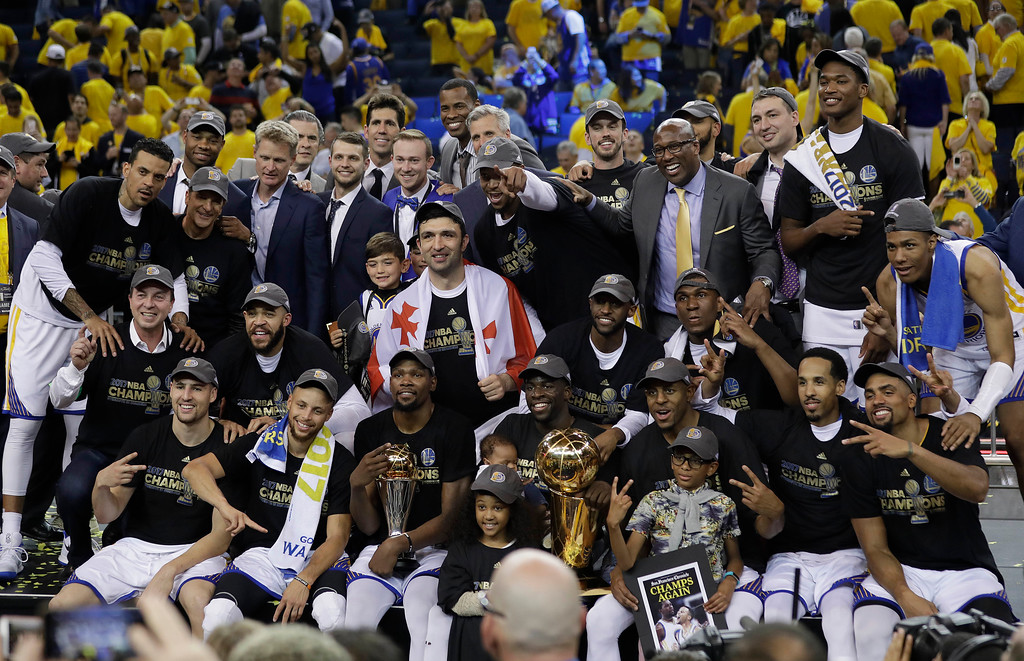 . Golden State Warriors players, coaches and owners pose for photos after Game 5 of basketball\'s NBA Finals against the Cleveland Cavaliers in Oakland, Calif., Monday, June 12, 2017. The Warriors won 129-120 to win the NBA championship. (AP Photo/Marcio Jose Sanchez)