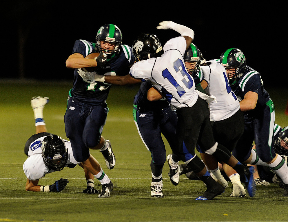 . HIGHLANDS RANCH, CO. - SEPTEMBER 13: Grizzlies\' running back  Matt Stanley (49) tried to break away from Grandview defensive back Cameron Knight (13) on a play in the second quarter. The ThunderRidge High School football team hosted Grandview at Shea Stadium Friday night, September 13, 2013.  Photo By Karl Gehring/The Denver Post