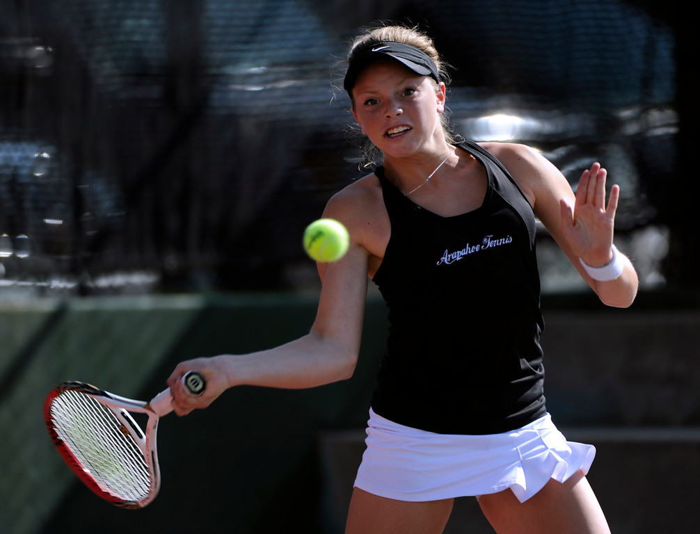 . Tate Schroeder from Arapahoe High School returns the ball to Kelli Woodman from Cherry Creek High School in the #1 Singles Bracket. (Photo By Kathryn Scott Osler/The Denver Post)